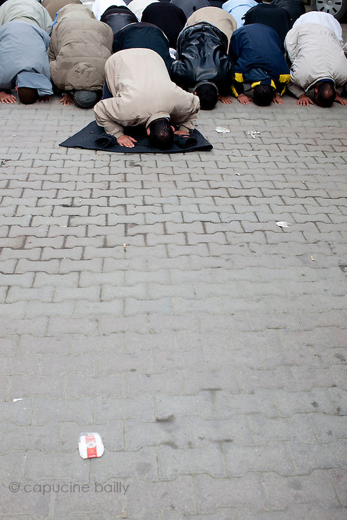 Tunis, Tunisia. January 26th 2011.Men pray in a street near the Casbah......