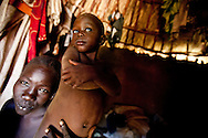 A mother and her child in a remote village in South Sudan that now has access to health care after years of conflict.