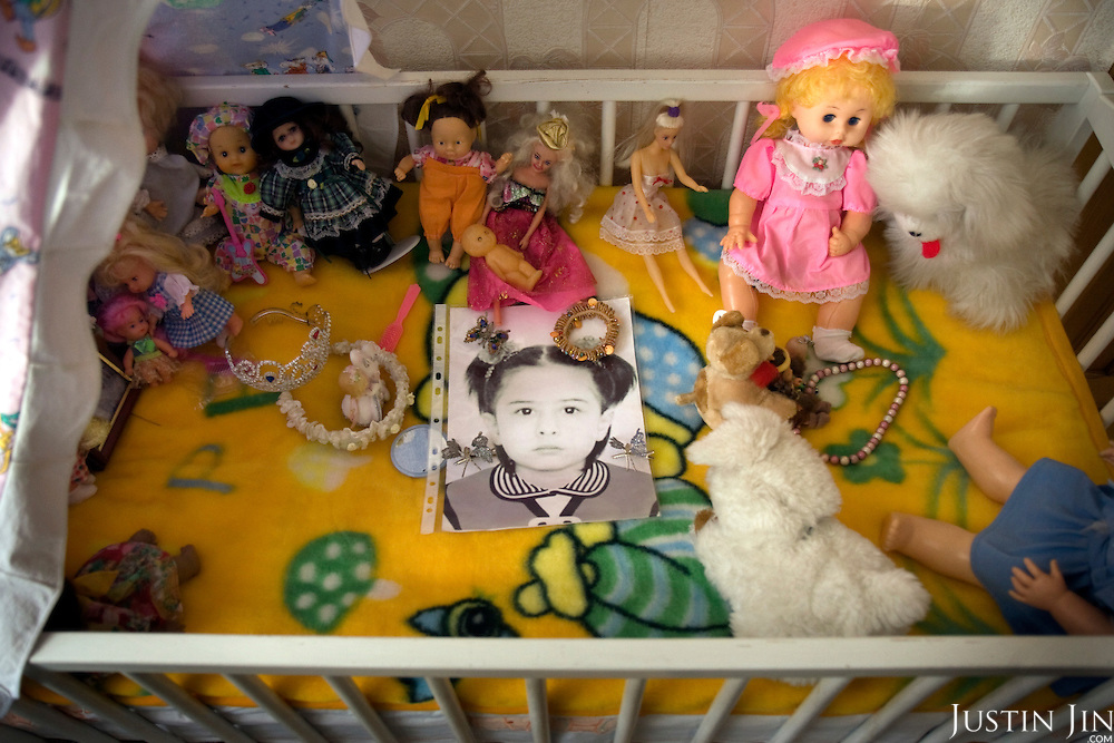The bed of Vitali Kaloyev's daughter Diana, left the way it did when she died when her plane crashed over Germany. .The 52-year-old architect, who killed the air traffic controller blamed for the plane crash in which he lost his wife and two children, is being treated as a national hero at home in Vladikavkaz, in North Ossetia in southern Russia. .Kaloyev, who was freed November 2007 from a Swiss jail after serving less than four years, was appointed deputy construction minister for his home region..Kaloyev was building a holiday villa in Spain for a wealthy Russian when his wife Svetlana, 44, 10-year-old son Konstantin and four-year-old daughter Diana, set out to join him for a holiday in July 2002. As their plane flew over Germany it collided with a cargo jet killing all 71 people on board, most of them Russian schoolchildren..Investigators later established that Peter Nielsen, a Dane working for Skyguide, the Swiss air-traffic control service at Zurich airport, was the only person on duty. He had panicked when he realised the two planes were on a collision course and gave wrong instructions to the pilots..Like other bereaved relatives, Kaloyev grew angry at the slow pace of the investigation and the way Skyguide, fearful of lawsuits, sought to place the blame on others..Kaloyev claims he cannot remember what happened next, but does not deny stabbing Nielsen several times with a pocket knife. Nielsen bled to death before an ambulance could reach him. Kaloyev was arrested the following day and was sentenced to eight years for manslaughter.