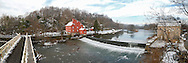 The famous Red Mill, falls and bridge at winter time, in Clinton NJ.