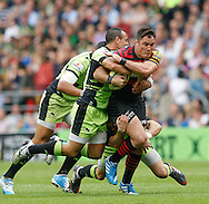Brad Barritt of Saracens (R) is tackled by Ken Pisi of Northampton Saints during the Aviva Premiership final at Twickenham Stadium, Twickenham<br /> Picture by Andrew Tobin/Focus Images Ltd +44 7710 761829<br /> 31/05/2014