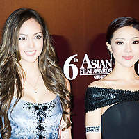 HONG KONG - MARCH 19:  Hong Kong model and actress Jessica Cambensy (L) and Chinese actress Deng Jia Jia pose at the red carpet during the 6th Asian Film Awards, celebrating excellence in cinema, at Hong Kong Convention and Exhibition Center on 19 March 2012 in Hong Kong, China The event honours specifically filmmakers achievements in the field of Asian cinema, bringing together the best cinematic talent in Asia.  Photo by Victor Fraile / studioEAST