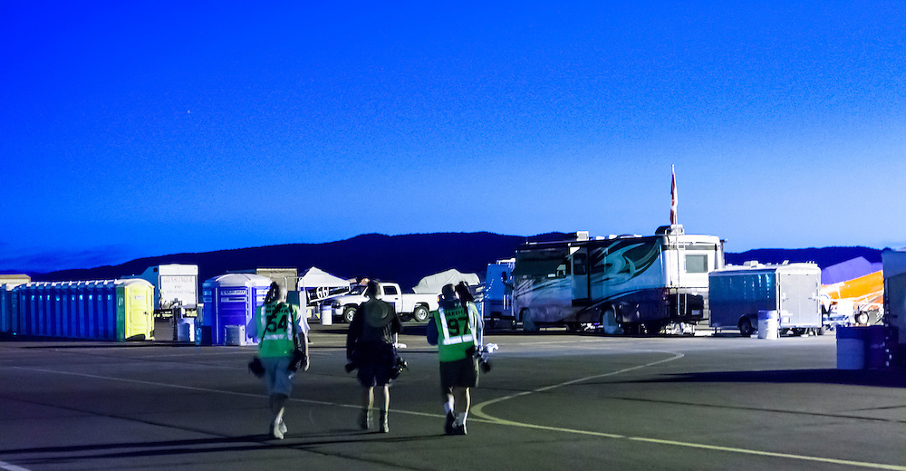 Photographers make their way out onto the tarmac in the dawn light at the 2012 Reno Air Races.