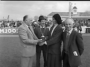 "Tattersalls Gold Cup At Punchestown..1986..24.04.1986..04.24.1986..24th April 1986..The Tattersalls Gold Cup was held at Punchestown today.The winner was ""Over the Last"" owned by Mr Austin Delaney and trained by Mt Thomas Carberry.Punchestown racecourse is at Naas,Co Kildare...Picture shows Mrs Fania Mahony,wife of Mr Denis Mahony,Chairman Tattersalls Ireland Ltd,presenting the Gold cup to Mr Patrick Flanagan. Mr Flanagan accepted the trophy on behalf of  Mr Austin Delaney (owner) who was unable to attend.At the back is Mr Thomas,(Tommy),Carberry who trained the horse, ""Over the Last""..Tattersalls Ireland based at Ratoath Co Meath is regarded as Europe's leading bloodstock auctioneer."