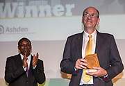 Dr Kandeh Yumkella, Director General of the United Nations Industrial Development Organisation. (UNIDO) presenting the Ashden UK Gold award to Peter Nixon of the National Trust. The 2012 Ashden Awards for sustainable energy ceremony at the Royal Geographical Society. London.