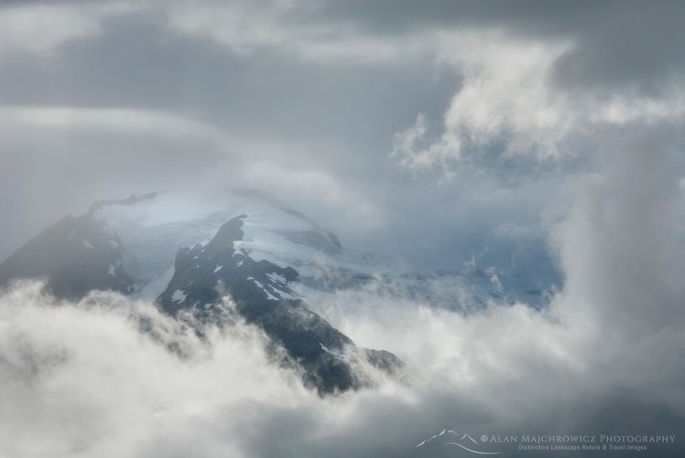 Peaks of the Chugach Range Alaska appearing through storm clouds