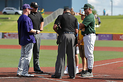 28 May 2017: Umpires Drew Ashcraft and Steve Bartelstein. Ryne Sandberg steps in as an assistant coach during a Frontier League Baseball game between the Lake Erie Crushers and the Normal CornBelters at Corn Crib Stadium on the campus of Heartland Community College in Normal Illinois