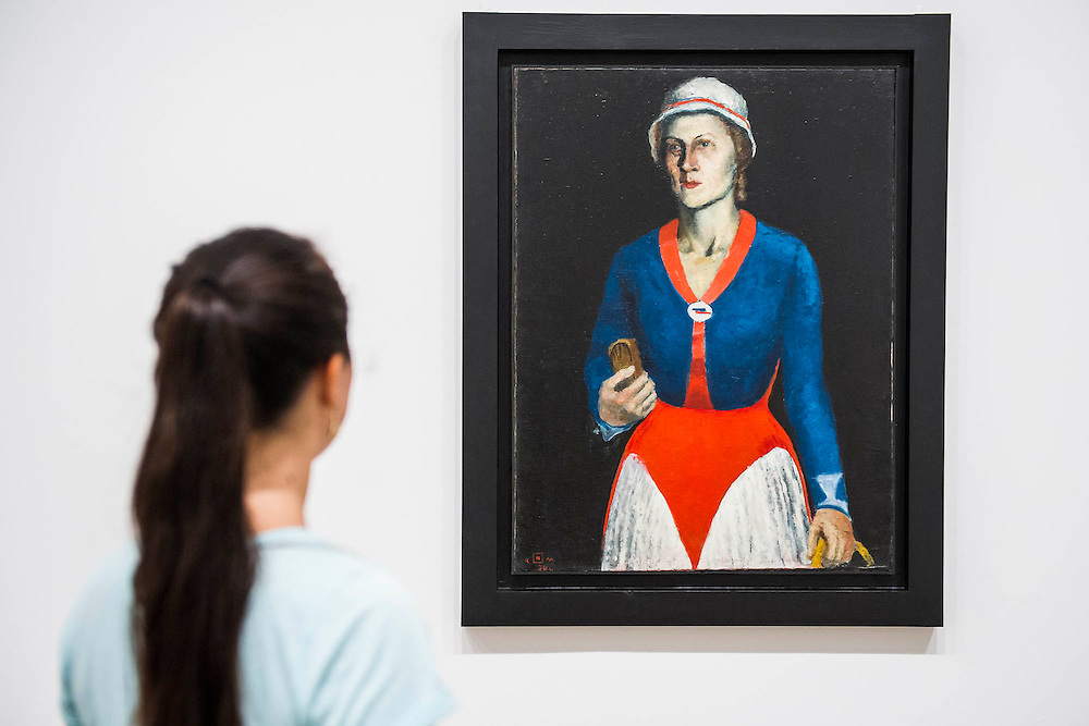 Tate Modern's new exhibition, of the avant-garde work of Russian Kazimir Malevich. Here a room full of his Last Paintings in the 1930's including here Portrait of The Artists Wife. Tate Modern, Bankside, London, UK.