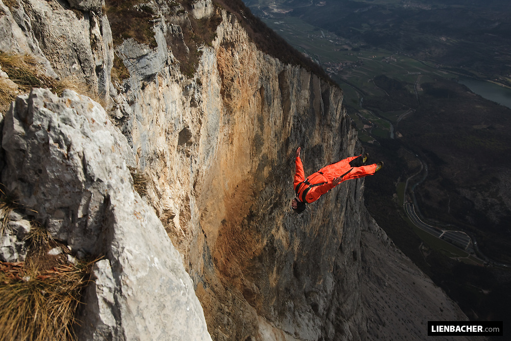 Pressurized Team Member Peter Salzmann performing a gainer from Mt. Brento in Italy