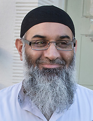© Licensed to London News Pictures. 19/10/2018. London, UK. Radical preacher ANJEM CHOUDARY smiles at photographers as he stands outside a bail hostel after being released form Belmarsh Prison in south-east London. Photo credit: Peter Macdiarmid/LNP