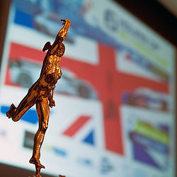 The figure at the top of the FIA-WEC Championship trophy with the advertising for the Silverstone 6hr race behind. At the FIA-WEC series launch in the Royal Automobile Club in Pall Mall, London on the 22nd March 2013. WAYNE NEAL | STOCKPIX.EU
