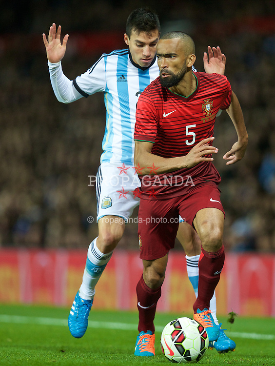 MANCHESTER, ENGLAND - Tuesday, November 18, 2014: Portugal's Jose Bosingwa and Argentina's Javier Pastore during the International Friendly match at Old Trafford. (Pic by David Rawcliffe/Propaganda)
