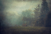 Man turning to walk away on a misty September morning near Müngsten, Germany - texturized photograph