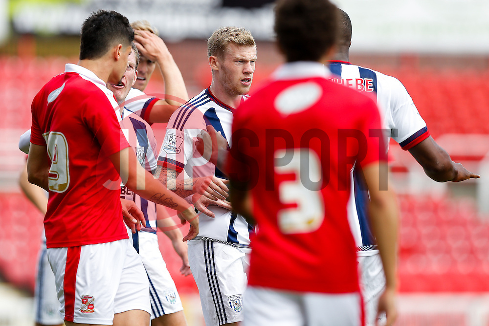 James McClean of West Brom is surrounded after a challenge - Mandatory byline: Rogan Thomson/JMP - 07966 386802 - 25/07/2015 - SPORT - Football - Swindon, England - The County Ground - Swindon Town v West Bromwich Albion - 2015/16 Pre Season Friendly.