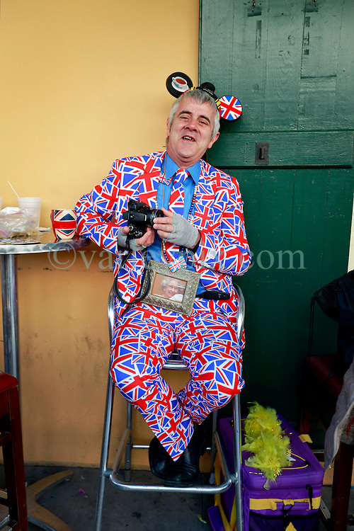 17 Feb 2015. New Orleans, Louisiana.<br /> Fat Tuesday. Mardi Gras Day. Englishman Phil Goddard relaxes on Bourbon Street as the sun goes down.<br /> Photo; Charlie Varley/varleypix.com