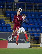 10th November 2017, McDiarmid Park, Perth, Scotland, UEFA Under-21 European Championships Qualifier, Scotland versus Latvia; Latvia's Vladislavs Sorokins competes in the air with Scotland's Scott Wright