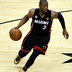 Jun 16, 2013; San Antonio, TX, USA; Miami Heat shooting guard Dwyane Wade (3) drives against the San Antonio Spurs during the second quarter of game five in the 2013 NBA Finals at the AT&T Center. Mandatory Credit: Derick E. Hingle-USA TODAY Sports