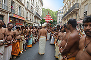 Men pulling the Ganesh float with long plant fibre ropes, in the parade celebrating the festival of Ganesh Chaturthi, marking the birth of the Hindu god Ganesha, on the streets of the La Chapelle area of the 18th arrondissement of Paris, France, on Sunday 1st September 2019. The annual religious festivities and parade take place near the Ganesha Temple of Paris, or Sri Manicka Vinayakar Alayam Temple, the largest Hindu temple in France. Ganesha is the elephant-headed Hindu God of Beginnings, son of Shiva and Parvati, who represents love and knowledge. Picture by Manuel Cohen