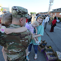 Molly Schade, 7, of Madison doesn't want to let go of her father, Lt. Justin Schade, as leaves Sunday morning from Tupelo to begin a 10 month in Kosovo with the 1-185th Aviation Regiment in support of Operation Joint Guard.