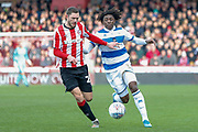Brentford defender Henrik Dalsgaard (22) battles for possession with Queens Park Rangers midfielder Eberechi Eze (10) during the EFL Sky Bet Championship match between Brentford and Queens Park Rangers at Griffin Park, London, England on 11 January 2020.