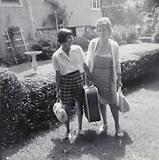 two friends ready to go on vacation 1968