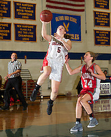 Belmont's Cassie Contigiani takes a shot guarded by Laconia's Cali Swormstedt during the Holiday Basketball Tournament held at Gilford High School Friday evening.  (Karen Bobotas/for the Laconia Daily Sun)