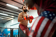 Johny Hendricks spars during a training session at Velociti Fitness in Pantego, Texas on February 6, 2014.