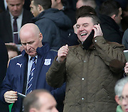 """""""You'll never believe who I'm sitting next to"""" - Celtic fan on phone next to John Brown - Celtic v Dundee,  at Celtic Park in the Clydesdale Bank Scottish Premier League.. - © David Young - www.davidyoungphoto.co.uk - email: davidyoungphoto@gmail.com"""