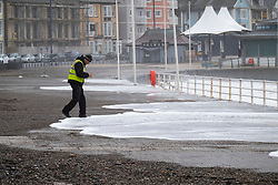 © London News Pictures. 04/01/2018. Aberystwyth, UK.  Shale washed up on to the promenade at Aberystwyth by storm Eleanor. Strong westerly winds gusting over 75 mph whipped the high Spring Tide into huge waves yesterday, that batter the seafront at Aberystwyth on the Cardigan Bay coast of west Wales. Photo credit: Keith Morris/LNP