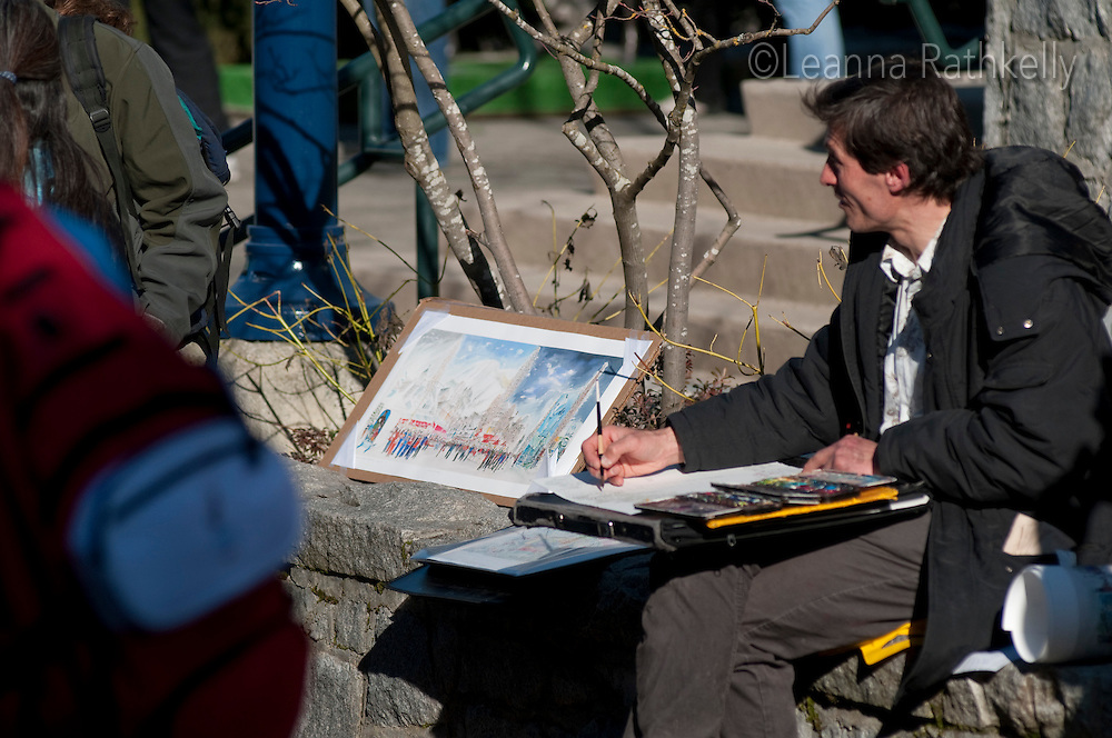 A painter shows his renditions of Whistler outdoors on a sunny day during the 2010 Olympic Winter Games in Whistler, BC Canada.