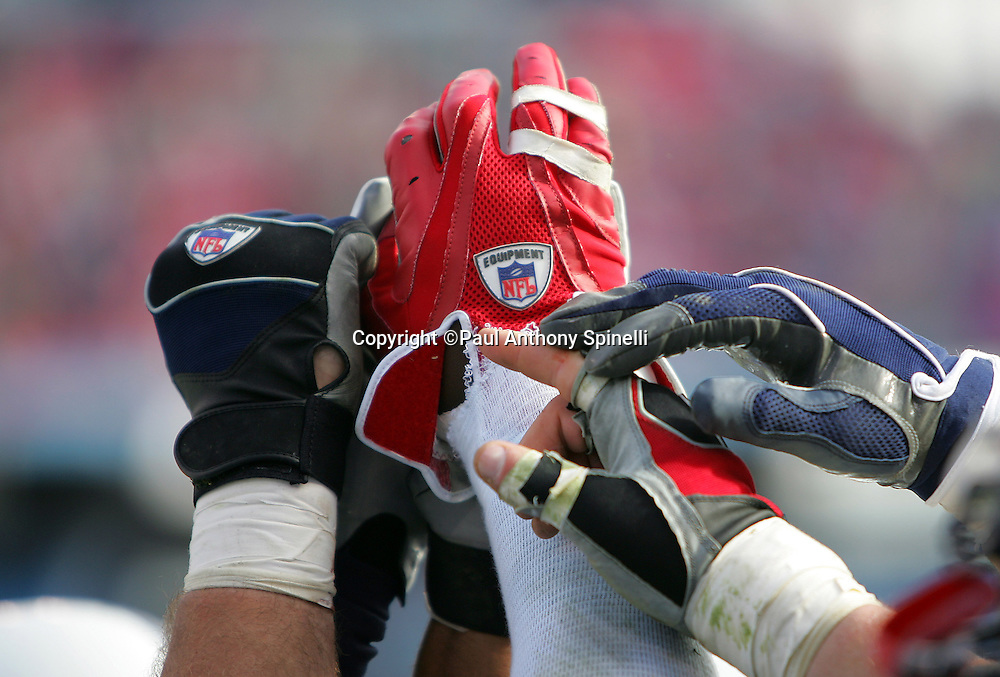 NASHVILLE, TN - DECEMBER 3:  A group of players hold gloved hands in unison during a pregame rally at the Tennessee Titans game against the Indianapolis Colts at LP Field on December 3, 2006 in Nashville, Tennessee. The Titans defeated the Colts 20-17. ©Paul Anthony Spinelli