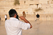 Israel, Jerusalem, Old City, Wailing Wall man blows Shofar