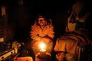 Rosarno, Italia - 19 dicembre 2010. Un immigrato all'interno della sua casa priva di elettricità a Rosarno..Ph. Roberto Salomone Ag. Controluce.ITALY -  An immigrant inside his home with no electricity in Rosarno on December 19, 2010.