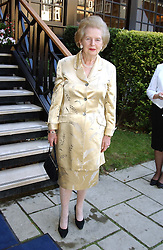 BARONESS THATCHER at a garden party at the Goring Hotel, Beeston Palce, London SW1 to celebrate the unveiling of a bronze bust the late Queen Elizabeth the Queen Mother on 20th July 2004.