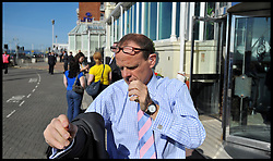 Chief Political Correspondent for the BBC News Norman Smith prepares to go air as the  Deputy Prime Minister Nick Clegg and Leader of the Liberal Democrats arrives at the Grand Hotel, Brighton, for the start of the Liberal Democrat Party Conference, Saturday September 22, 2012 Photo Andrew Parsons / i-Images..