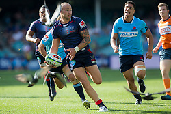 March 17, 2018 - Sydney, NSW, U.S. - SYDNEY, NSW - MARCH 18: Rebels player Reece Hodge (12) breaks through Waratahs defence at round 5 of the Super Rugby between Waratahs and Rebels at Allianz Stadium in Sydney on March 18, 2018. (Photo by Speed Media/Icon Sportswire) (Credit Image: © Speed Media/Icon SMI via ZUMA Press)