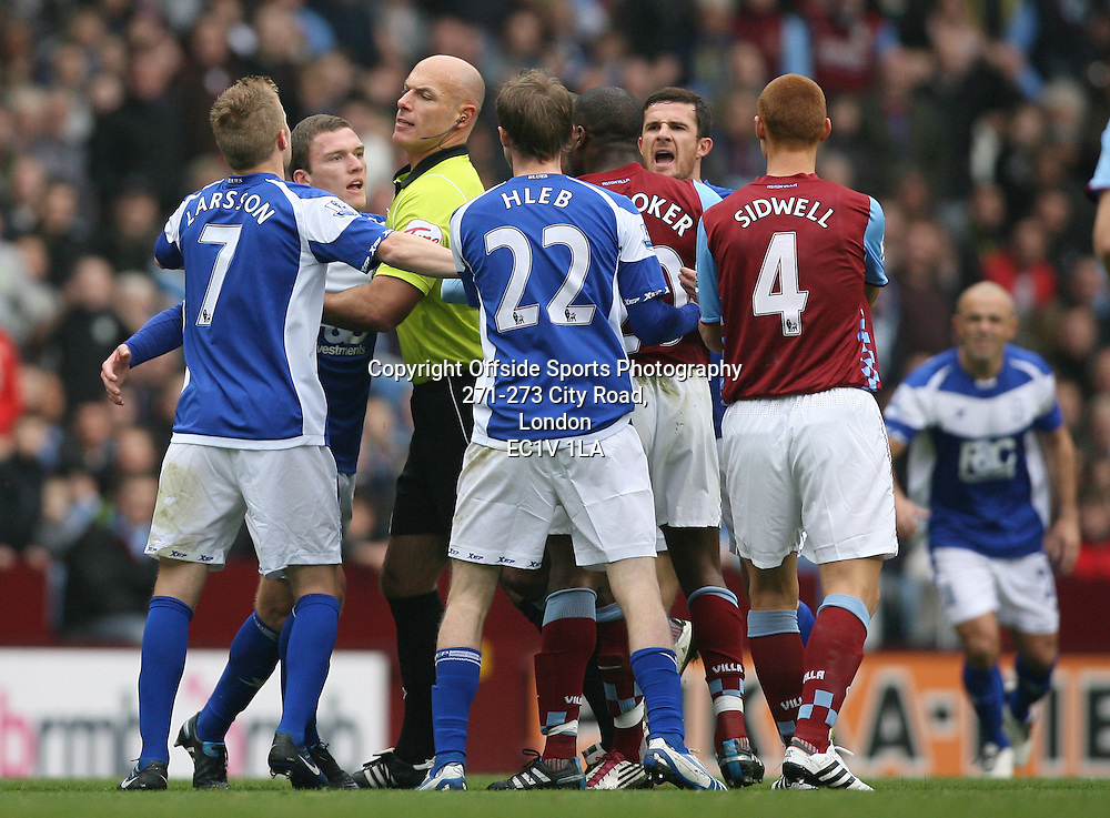 31/10/2010 - Barclays Premier League - Aston Villa vs. Birmingham City - Referee Howard Webb intervenes to break up a tussle between Craig Gardner of Birmingham and Nigel Reo-Coker of Villa - Photo: Simon Stacpoole / Offside.