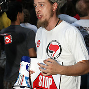 A supporter gives a television interview during an Occupy Orlando public demonstration in support of Occupy Wall Street gatherings across the country, at the Orange County History Center on Wednesday, October 5, 2011 in Orlando, Florida. (AP Photo/Alex Menendez)