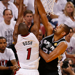 Jun 20, 2013; Miami, FL, USA; San Antonio Spurs power forward Tim Duncan (21) blocks the shot of Miami Heat center Chris Bosh (1) during the first quarter of game seven in the 2013 NBA Finals at American Airlines Arena. Mandatory Credit: Derick E. Hingle-USA TODAY Sports