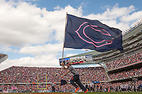 06 October 2013: a Chicago Bears flag runner runs across the field after a Chicago Bears field goal against the New Orleans Saints during the first half of the Saints 26-18 victory over the Bears in an NFL Game at Soldier Field in Chicago, IL.