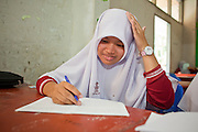 "Sept. 29, 2009 -- SAI BURI, THAILAND: A girl in an Islamic studies class at the Darunsat Wittya Islamic School in Sai Buri, Thailand. The school is the largest Muslim high school in Pattani province. Although it is a private school, the Thai government pays students' tuition to attend the school. The curriculum combines Thai official curriculum with Islamic curriculum. Many of the students go on to college level education in Egypt and Saudi Arabia. The Thai government views Islamic high schools with suspicion, fearing they radicalize students. Thailand's three southern most provinces; Yala, Pattani and Narathiwat are often called ""restive"" and a decades long Muslim insurgency has gained traction recently. Nearly 4,000 people have been killed since 2004. The three southern provinces are under emergency control and there are more than 60,000 Thai military, police and paramilitary militia forces trying to keep the peace battling insurgents who favor car bombs and assassination.   Photo by Jack Kurtz / ZUMA Press"