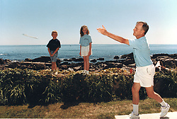 United States President George H.W. Bush pitches horseshoes as his grandchildren look on at Walker's Point in Kennebunkport, Maine on August 8, 1991.<br /> Mandatory Credit: David Valdez / White House via CNP /ABACAPRESS.COM