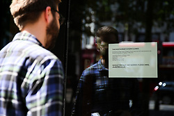 © Licensed to London News Pictures. 21/05/2019. London, UK. A man reads the notice on the window of Jamie's Italian in Islington branch, north London as Jamie Oliver's chain restaurants goes into administration leaving more than 1,000 jobs at risk. The administration is handled by KPMG as per the notice dated 21 May 2019. Photo credit: Dinendra Haria/LNP