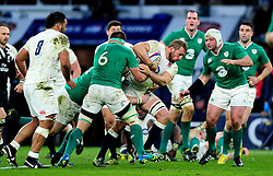 Chris Robshaw of England takes on the Ireland defence - Mandatory byline: Patrick Khachfe/JMP - 07966 386802 - 27/02/2016 - RUGBY UNION - Twickenham Stadium - London, England - England v Ireland - RBS Six Nations.