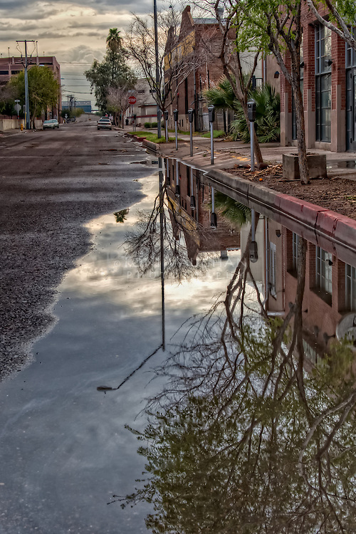 Street reflections in a puddle in downtown Phoenix.