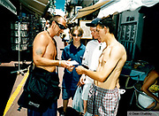 Man handing out flyers to passers by Ibiza 1999