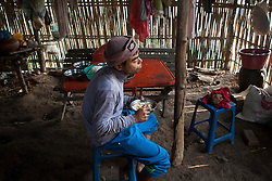 Ko Aung Myo having breakfast after the hard work in the palm tree tops. At Ka Myaw Gyi village in the outskirts of Dawei, Myanmar.