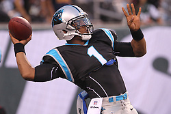 Aug 26, 2012; East Rutherford, NJ, USA; Carolina Panthers quarterback Cam Newton (1) throws a pass during warmups for their game against the New York Jets at MetLife Stadium.