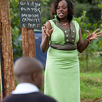 Cathy speaks with youth participants of the Mt. Kenya Marvelous Fraternity.  Nearly 3,700 young people have been trained in volunteer leadership through the program.