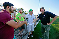 07 May 2016. New Orleans, Louisiana.<br /> NPSL Soccer, Pan American Stadium.<br /> Head coach Kenneth Farrell (rt) greets his opponents with fellow head coach Brendan Keyes (in white) of the Houston Hurricanes before kick off for the first game of the season as the New Orleans Jesters take on the Houston Hurricanes. Jesters win 3-0. <br /> Photo; Charlie Varley/varleypix.com